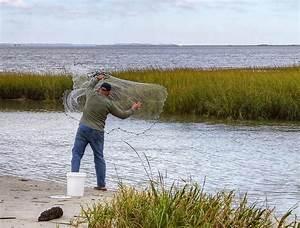 Man Throwing Fishing Net Photograph by David Byron Keener