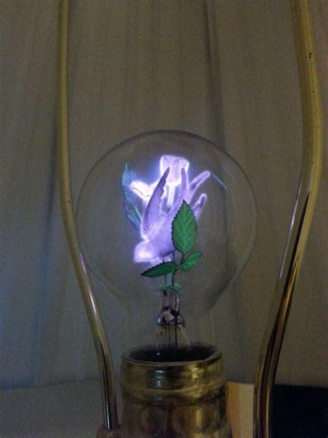 flowers in light bulbs vintage working aerolux duro test lightbulb metal roses