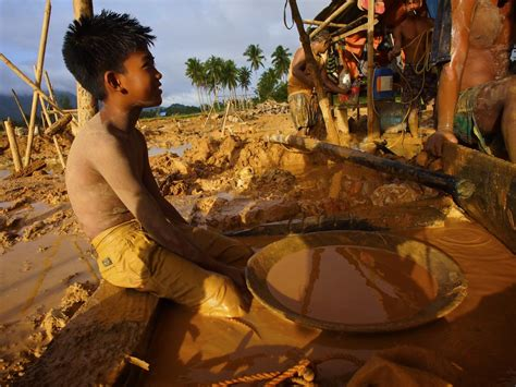 southeast asia child miners pay price  gold pulitzer