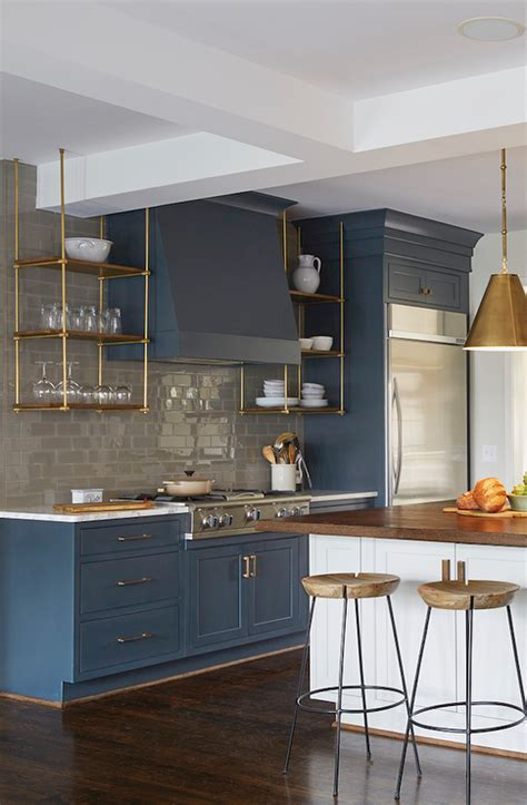 Wood And Brass Kitchen Shelves Suspended From The Ceiling