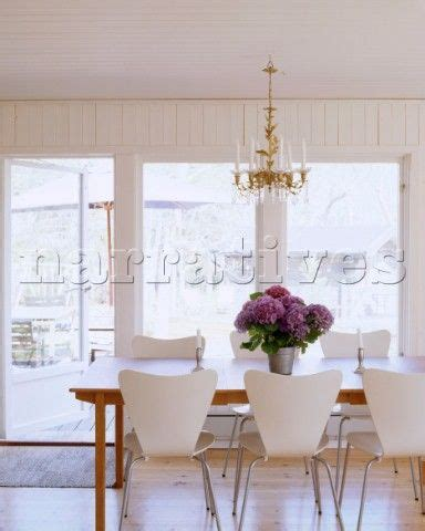 a modern scandinavian style dining room with wooden dining