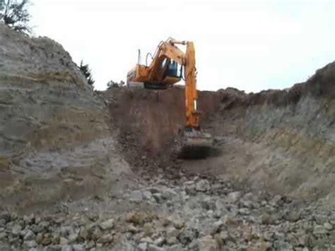 excavator digging  pond youtube