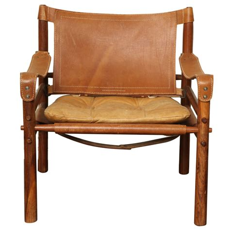 fancy arne norell safari leather chair