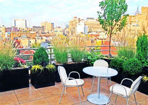 manhattan roof garden paver deck terrace container plants grasses bistro contemporary