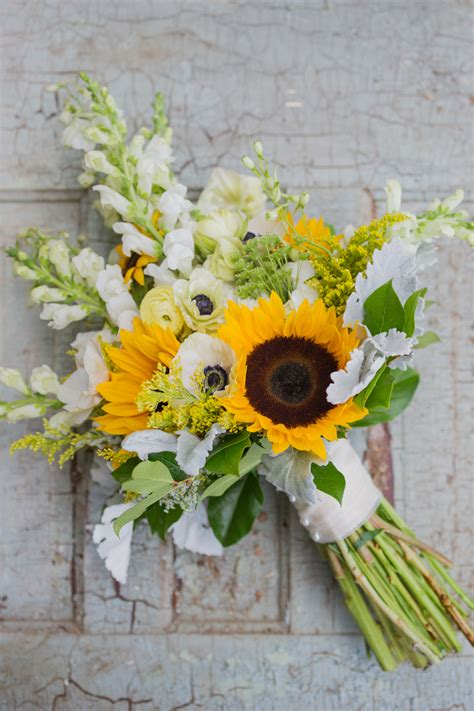 warmth  happiness  perfect sunflower wedding bouquet