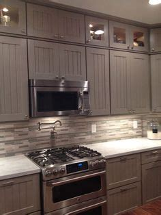 tiling a kitchen grey cabinets black appliances silver hardware 2816