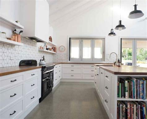 polished concrete flooring, white cabinets, wood