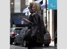 Kate Moss spotted puffing on a cigarette during London