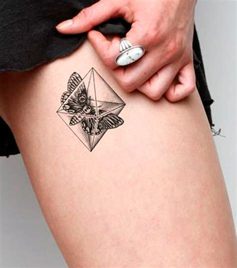 Photo  Tatouage Cuisse, Papillon