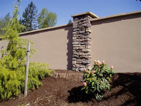 stucco fence ideas stucco retaining wall help choose retaining wall material landscape design forum