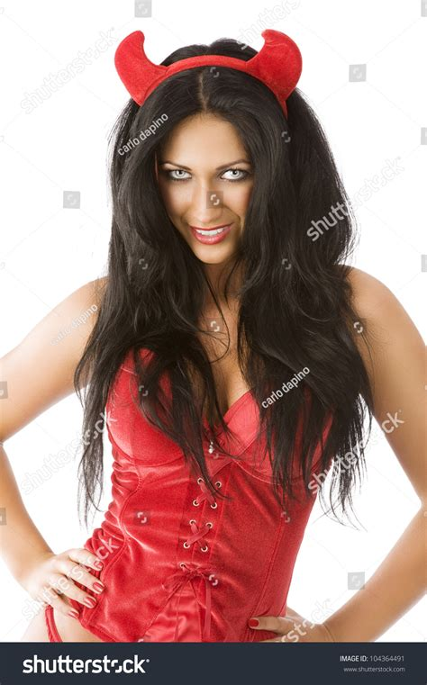 Close Up Of A Cute Brunette With Red Horns Like A Devil She Is In Front Of The Camera Looks In