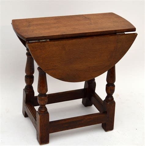 Small Antique Solid Oak Drop Leaf Occasional Table. Strut Table. Round Breakfast Table Set. How Tall Is A Coffee Table. Correct Ergonomic Desk Setup. Tiffany Table Lamp. Linnmon Ikea Desk. Kitchen Tables And Chairs. Ladder Bookcase With Drawers