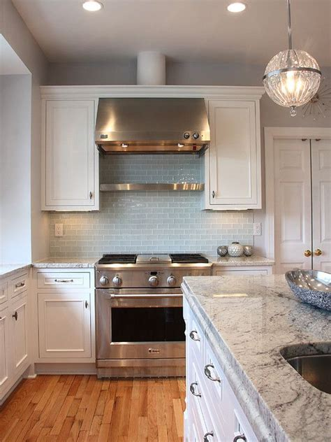 light blue subway tile backsplash