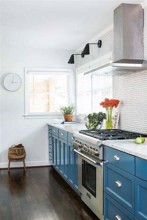 blue base cabinets with white granite countertops
