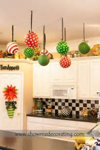 christmas decor oversized christmas ornaments tied with coordinating ribbon suspending from the