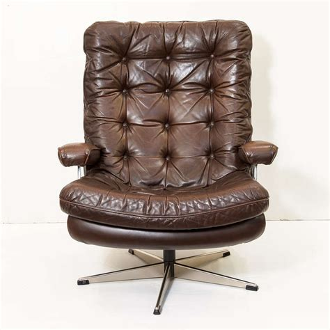 swivel lounge chair of tufted leather one