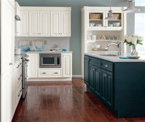 kitchen in homecrest white glazed cabinets with blue kitchen island homecrest