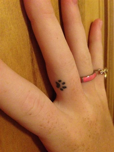 small finger tattoo paw print hair piercings  tats