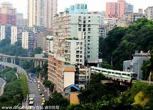 Light rail pass through building in Chongqing[1 ...