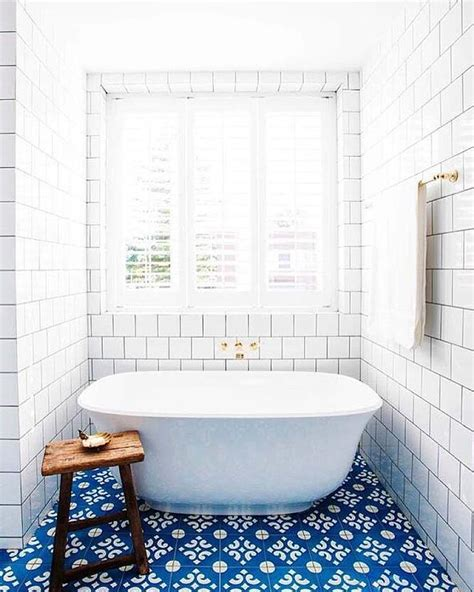 white bathroom with blue mosaic floor tiles transitional