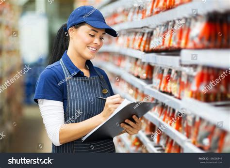 Beautiful Young Hardware Store Worker Stock Stock Photo