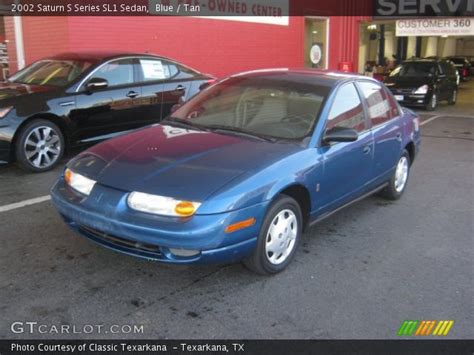 Blue  2002 Saturn S Series Sl1 Sedan  Tan Interior