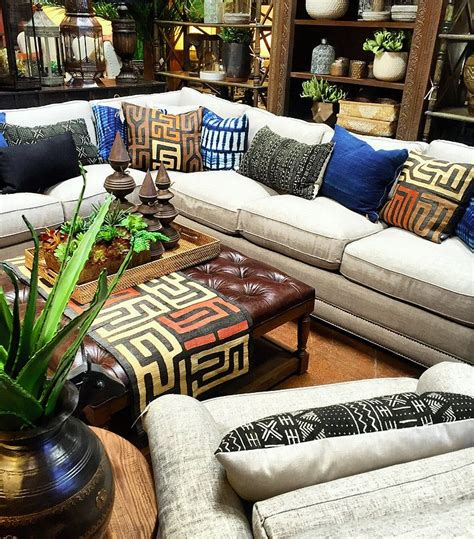 boho luxe living room  african textiles  leather
