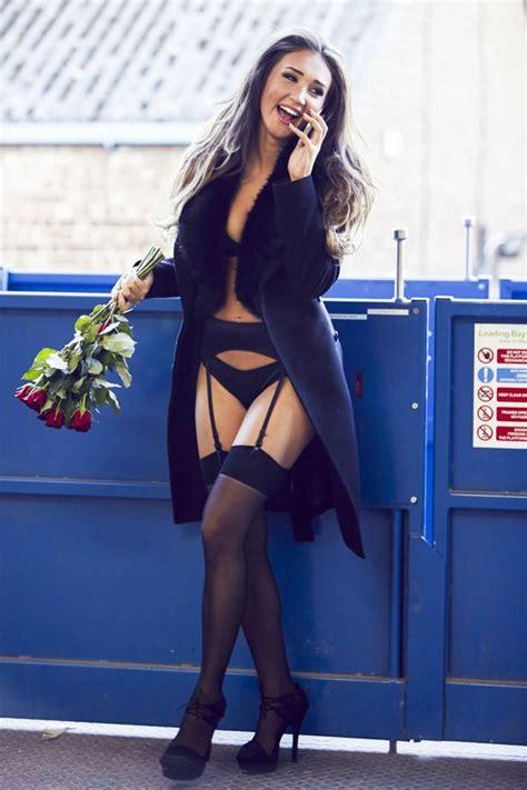 megan mckenna dons black lace lingerie  suspenders