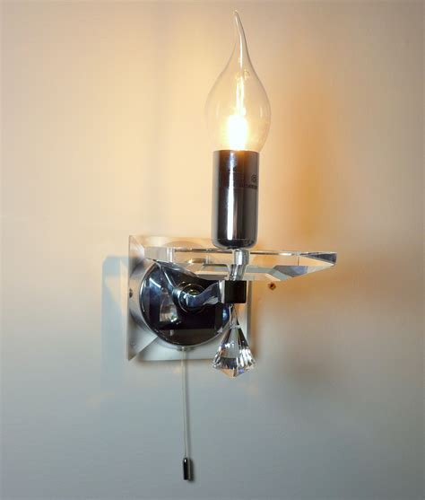 polished chrome and wall light with tipped glass shade