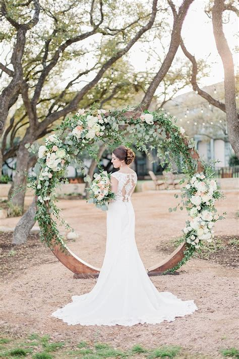 Circle floral ceremony arch Garden Party Wedding
