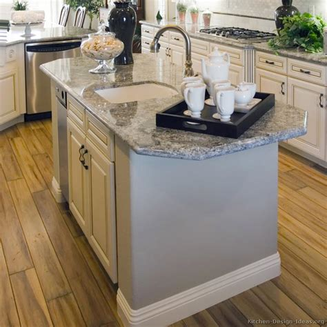 kitchen island countertop overhang antique white kitchen with wood floors and an island sink