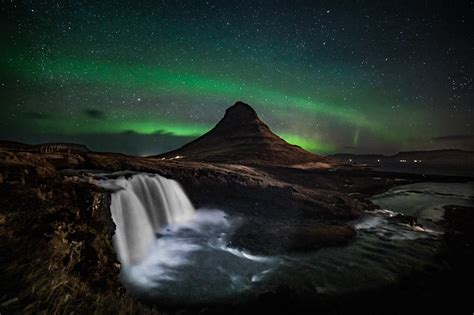 Northern Lights Dancing Over Kirkjufell Mountain Iceland