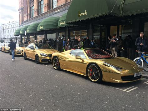 Fleet Of Luxury Cars Painted Gold Lines Up Outside Harrods