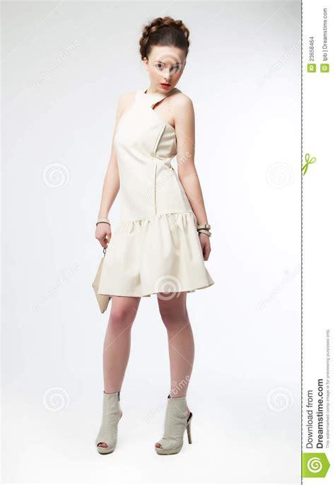 Beautiful Model And Dressed Beautiful Fashion Model In White Dress Posing Stock