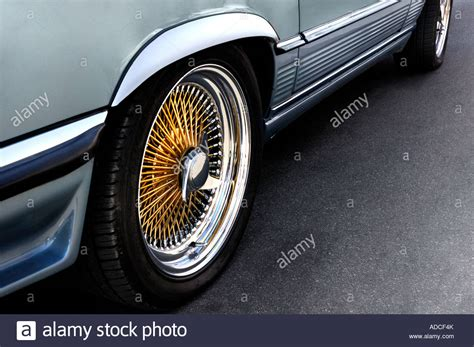Classic Car Wheels And Shiny Rims Stock Photo, Royalty