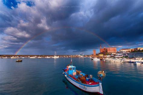 Napoli societa' sportiva calcio s.p.a. Torre del Greco, spunta un arcobaleno sul porto - la ...
