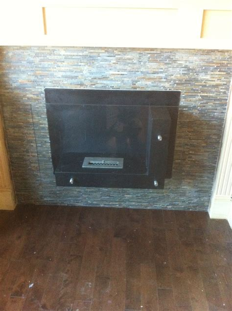 slate stacked fireplace surround by stepping