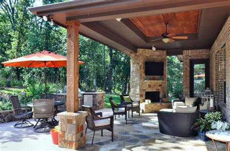 modern patio with custom outdoor fireplace by atkins
