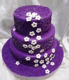 Purple Wedding Cake With White Flowers - Arabia Weddings