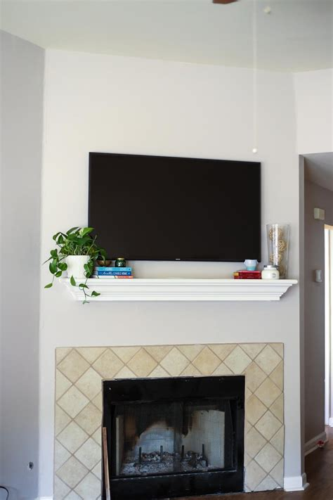 decorating fireplace mantel with tv above how to decorate a mantel with a television