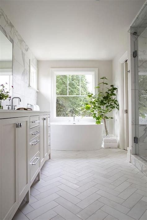 Modern White Bathroom Floor Tile by Welcoming White Bathroom Is Fitted With Honed White Marble