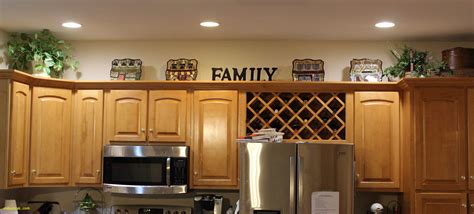 decorating top of kitchen cabinets unique top of kitchen cabinet decor home design ideas 8579