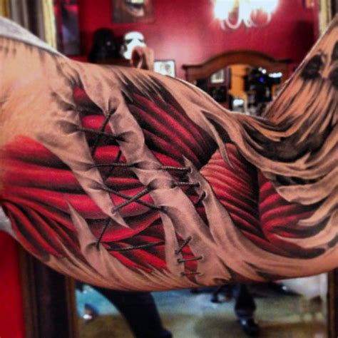 muscle tattoo designs  men exposed fiber ink ideas