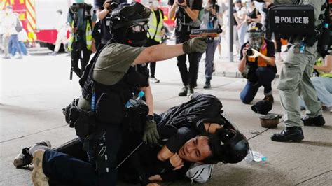 Hong Kong: Police make first arrests under controversial ...