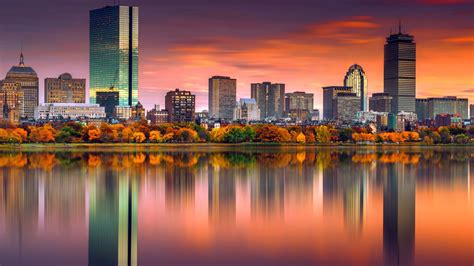 colorful boston building reflection on river surrounded by ...