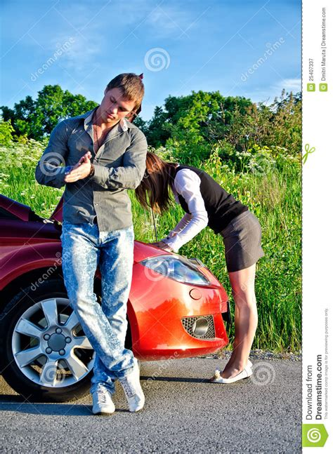 couple repairs  broken car royalty  stock photography