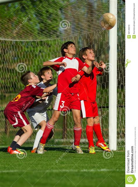 boys playing soccer stock photo image  playing