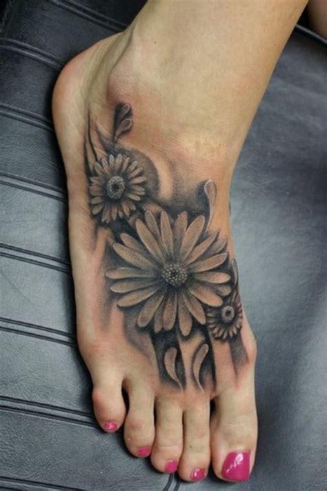 black  white flower foot tattoo