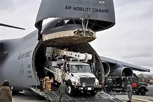 File:U.S. Air Force airmen unload power repair equipment ...