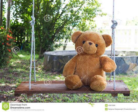 Teddy Bear On Swing. Stock Photo
